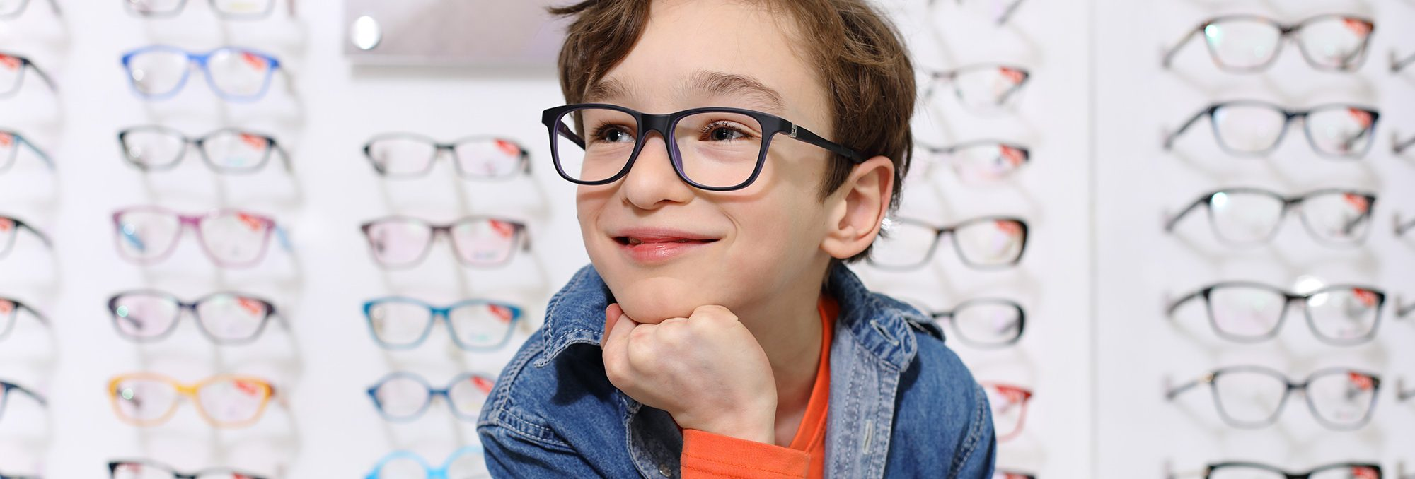 A boy with a denim shirt and glasses