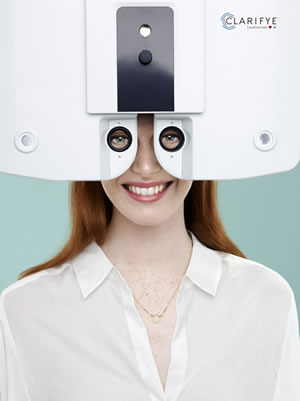 woman using a phoropter to test vision